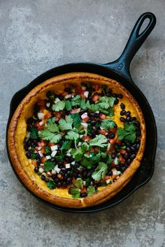 As much as I love regular pancakes, there's something about Dutch babies that elevates them to the status of something special. Even though they're surprisingly easy to make, they're so impressive when they emerge out of the oven all puffed up and proud. Since I tend toward savory rather than sweet breakfasts, this Dutch baby, loaded with spicy roasted chiles and melty cheese, is right up my alley.
