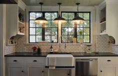 The renovated kitchen in Nathan Waldon and Tom Berkelman's Tudor-style home in the Crocker Highlands area of Oakland. In keeping with their perception of the home's era, the couple chose soapstone counters, mini subway tiles for the backsplash, a farmhouse sink, bead-board surfaces and terra-cotta floor tiles.
