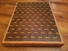 This gorgeous end grain cutting board, made by my talented husband, is the perfect center of attention to any room!! It measures 12×16×1.625, and has 235 individually cut pieces, placed strategically to create this beautiful masterpiece! Made with Walnut, and Maple woods Seasoned