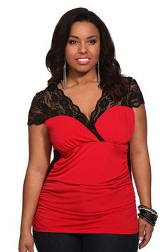 Red With Black Lace Inset Surplice Top  On-trend black lace insets, along the shoulders and sides, delicately accent this vivid red top. The stylish surplice design features ruched seams for a flattering silhouette. $38.50
