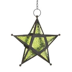 Green Hanging Glass Star Lantern. Unique decorative green star shaped hanging candle lantern. This decorative lantern will make unique accent decor for any room of your home.