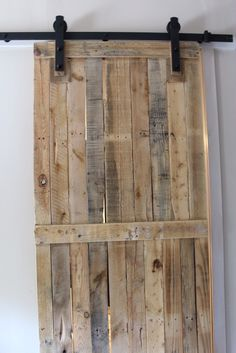 Pallet Furniture Ideas Come check out the Pallet Barn Door We Made using only 2 Pallets! - A pallet sliding barn door adds a lot of character, saves space, looks amazing, and is cheap and easy to make. Learn how to build it and build yours today! Pallet Door, Pallet Barn, Pallet Walls, Diy Barn Door, Barn Wood, Pallet Furniture, Pallet Wall Bedroom, Furniture Ideas, Diy Pallet Wall