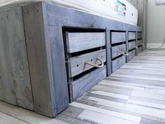 As we have said earlier that this reclaimed wood pallet giant bed idea has the storage option, you can see here that you can also place the big items in the drawers created below the bed attaching to it. There is no handle attached to them for opening them, the rope idea is unique and it is looking attractive.