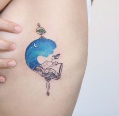 Book under the Blue Sky. Another amazing book tattoo design is next on our list. The book is shown lying under the blue sky and moon with the paper air plane flying.