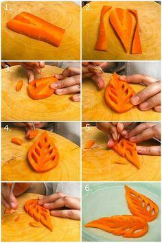 Hier is te zien hoe men een herfstblad kan snijden uit een wortel.