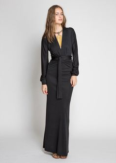 The Olatz dress should be your absolute MUST HAVE.    The 100% silk knit jersey flows nicely down the body with  a gorgeous long tie that wraps the waist in any manor you wish to tie.  Wrap the tie once around your waist or 3 times. 3 inch cuff at the wrist with extra fabric in the long arms to adjust any way you wish.  Makes for a beautiful blouson sleeve. V neck. Any Body, Any time of Day. Chic and Cosmo tied up in one!