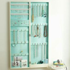 Great idea for a girls dorm room or apartment, mirror on the front side. Or take a picture frame, make it a hinge so it opens like this and make the part for jewelry corkbased or chicken wire. Add a vintage looking door nob for an accent and boom.