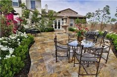 Stamped concrete gives you that old world classic lookand sence scale. The concrete is continous (no weeds to pluck), comes in mant natural earth tone colors and may stamp styles from brick to stone or granite. Great look and little upkeep.