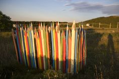 Color fence hiding garbage cans Fatima