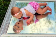 Cute baby picture idea even with a toddler that is sitting up and looking down at the mirror. Description from pinterest.com. I searched for this on bing.com/images