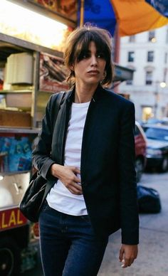 Mica Arganaraz in a simple but classic white tee, dark denim, and black blazer