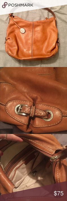 Michael Kors Leather Hobo Purse Medium sized leather hobo with gentle use. Only flaws on bag are wear on strap and one small pen mark on the otherwise flawless interior. Supple leather, silver accents and perfect tan coloring. 💯 real Michael Kors! Michael Kors Bags Shoulder Bags