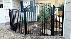 Decorative iron fencing and arched gate - front yard landscaping ideas curb appeal Courtyard Landscaping, Courtyard Design, Front Yard Landscaping, Landscaping Ideas, Diy Fence, Fence Ideas, Wrought Iron Garden Gates, Iron Gates, Yard Privacy