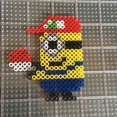 Minion Pokemon trainer perler beads by knoxy_beads Melty Bead Designs, Melty Bead Patterns, Pearler Bead Patterns, Perler Patterns, Beading Patterns, Hama Beads, Pokemon Perler Beads, Perler Bead Art, Fuse Beads