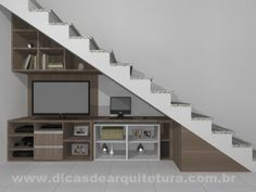 Móvel de madeira embaixo da escada. http://dicasdearquitetura.com.br/movel-para-tv-embaixo-da-escada/