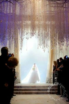 Hanging orchids and perfect lighting set the stage for the Bride to enter! #wedding #ceiling #orchids