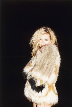 Kate Moss by Jurgen Teller. i like the off centre model, simply black backdrop and big, heavy looking fur coat.