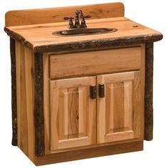 Loon Peak® <p></p><strong>Features:</strong><ul><li>Bathroom vanity base</li><li>Individually handcrafted</li><li>Clear coat catalyzed lacquer finish for extra durability</li><li>Cleary collection</li><li>Base Finish: </li><li>Base Material: Solid Wood<ul><li>Base Material Details: Hickory</li><li>Wood Species: </li></ul></li><li>Number of Sinks Accommodated: 1</li><li>Mounting Type: Free-standing</li><li>Cabinets Included: Yes<ul><li>Number of Cabinets: 1</li><li>Number of Doors…