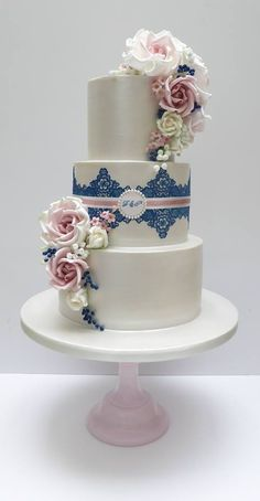 Floral and lace tiered wedding cake. | floral wedding cakes | cake design |