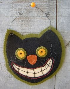 """Make this """"Scaredy Cat"""" with wool applique and perle cotton. So quick and cute! By Robin Kingsley via Bird Brain Designs."""