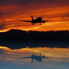 airplane silhouette on horizon