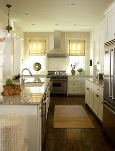 Our cabinets painted and with crown