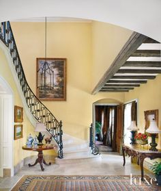 Traditional Yellow Foyer with Exposed Beams