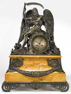A Charles X bronze and marble clock, circa 1830, surmounted by a seated figure of Chronos