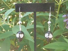 FOR TODAY ONLY- take advantage of my double sale!  Use coupon code JULY30 for 30% off plus FREE shipping to US and Canada!    Black Skull and Silver Roses Dangle Earrings by EBLDesigns on Etsy, $15.00
