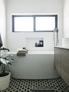 Compact but stylish black and white bathroom