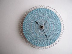 a little retro, a bit modern, just a touch dainty, and utilitarian to boot. my doily clocks are made of soft plastic, cork, and acrylic paint,
