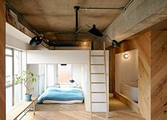 Two box units contain the bedroom and bathroom in this Kangawa apartment, which was renovated by 8 Tenhachi to create an open space for their own family