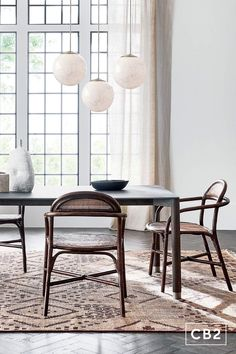 A modern, curvaceous design that comes to us from the Italian father/daughter duo behind Balutto Associati. Handcrafted dining chair is framed in dark brown rattan with handwoven rattan for both back and seat. Anchored together with wrapped rattan for that extra special touch. Learn about Balutto Associati on our blog. CB2 exclusive. Rattan Dining Chairs, Dining Room Furniture, Home Furniture, Dining Tables, Kitchen Chairs, Furniture Ideas, Kitchen Dining, Entryway Cabinet, Large Candle Holders