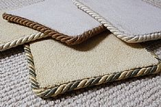 Got a carpet scrap? Make a runner! Just use your glue gun and some fabric store rope. Carpet Binding for Hallway Carpet Runners...