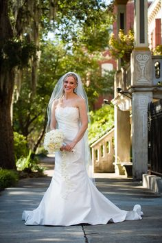 Gorgeous photo of the bride wearing her mother's wedding dress in Savannah, Georgia with photos by Scott Hopkins Photography | via junebugweddings.com