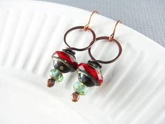 Copper Earrings Wire Wrap Earrings Red Earrings Wire Wrapped Jewelry Copper Jewelry Hoop Earrings These pretty wire wrapped earrings are made using a handmade balled head pin of copper wire that has been hand-forged and into an attractive design and hammered for strength. Accented with