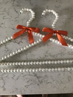 Our pearl hangers make a unique bridesmaids gift.  We can customize the ribbon color to match your wedding colors.  Our hangers are perfect for taking pictures with bridesmaids dresses on your big day!