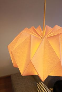 DIY origami lamp. I really want to make a couple of these to light up the dark winter nights.