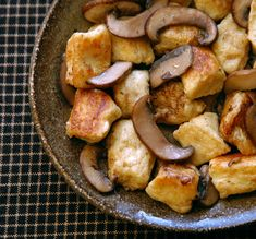 pan-fried gnudi with brown butter and mushrooms