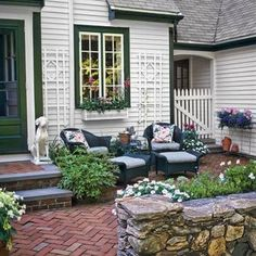 39 Budget-Wise Ways to Create Outdoor Rooms Front-Entry Courtyard Carve out a seating area in the front yard by enclosing a swath with a DIY sitting wall made from mortared fieldstone. Courtyard Landscaping, Front Courtyard, Small Backyard Landscaping, Backyard Patio, Landscaping Ideas, Mulch Landscaping, Patio Courtyard Ideas, Front Entry Landscaping, Small Brick Patio