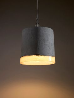 Netherlands-based industrial designer Renate Vos created a series of experimental pendant lamps using an unusual combination of concrete and silicone rubber.    Read more at Design Milk: http://design-milk.com/concrete-and-rubber-lamps-by-renate-vos/#ixzz2Iig3Zp3w