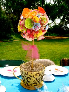 Whimsical colorful Alice in wonderland tea party paper rose topiary in tea cup centerpiece- like the idea, not the colours