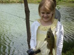 7-year-old Kaylee Jo going fishing. Submitted by Mindy C. -- Choose your favorite photo and submit your vote by August 6, 2012 for a chance to win a gift card for children's books!