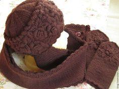 Купить или заказать Шапочка с ушками с ручной вышивкой Шоколад в интернет-магазине на Ярмарке Мастеров. Теплая зимняя шапочка уютного шоколадного цвета . Длинные ушки можно и нужно обернуть вокруг шеи ,застегнув на красивую пуговицу , и забыть , что на дворе холодно и снежно ! Шапочка связана спицами и украшена ручной вышивкой . Носите с удовольствием и будьте готовы ко всеобщему вниманию окружающих !!!