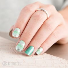 Chevrons are always in! New from Jamberry- Ferris Wheel nail wraps mixed with the solid new wrap Mint Sparkle. A very springy sparkle look! Emily Nelson-Independent Jamberry Consultant