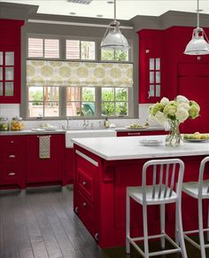 gray and red/champagneish color - Opposite this... Gray cupboards, red walls.