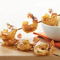 Spicy Grilled Shrimp - To make these fuss-free skewers, simply marinate shrimp in oil and Cajun seasoning before grilling. Warm orange marmalade makes a delicious (and super simple) topper.