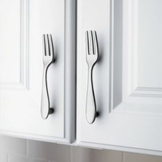 Kitchen cabinets...forks for upper cabinets, spoons for lower ones and knives for drawers