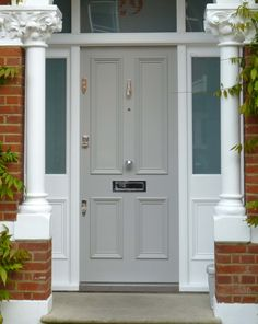 A pretty Victorian door design with period mouldings, delicate polished chrome door furniture and a hand-painted matte finish in a soft shade. Cottage Front Doors, Victorian Front Doors, Wood Front Doors, House Front Door, Painted Front Doors, Entry Doors, Traditional Front Doors, Welcome Signs Front Door, Front Door Locks