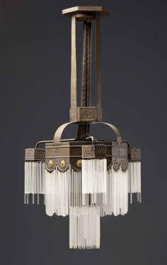 Classic deco lines. Photog. Unknown. Art Deco Chandelier:
